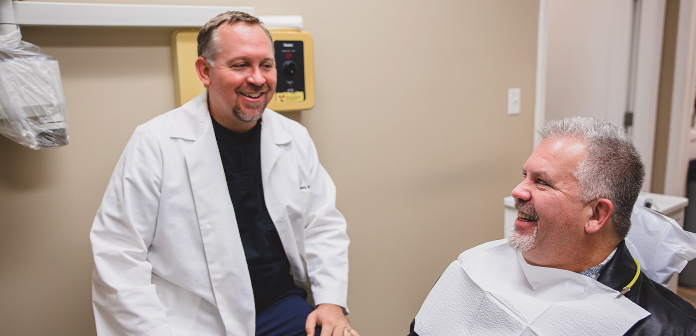 Doctor Owens laughing with dental patient