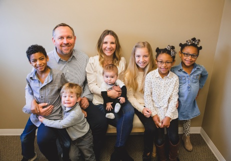 Family with six young kids at dental office for children's dentistry