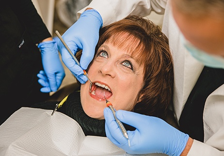 Woman receiving periodontal therapy